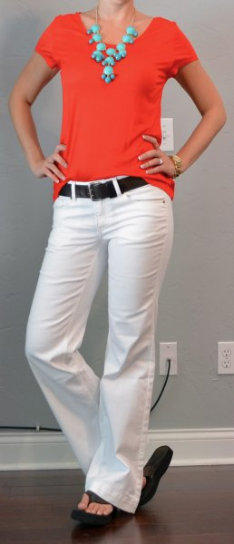 red tee with white flared jeans