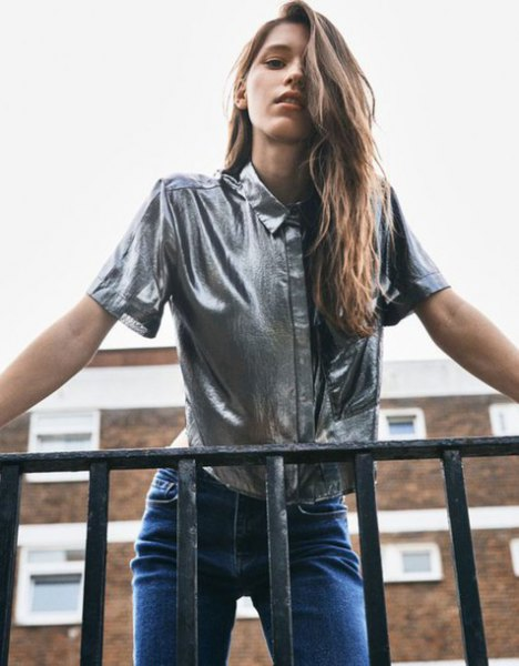 silver metallic short sleeve shirt with blue jeans
