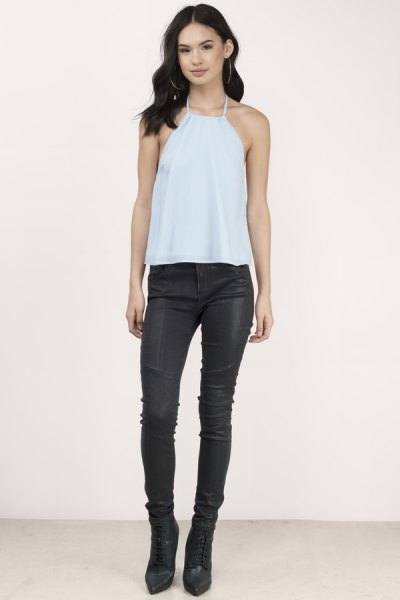 sky blue halter neck tank top with black leather pants