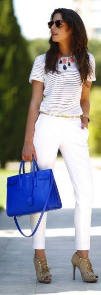 striped tee with white chinos and royal blue leather purse