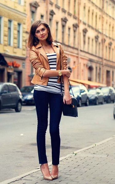 tank leather jacket with black and white striped tee and dark skinny jeans