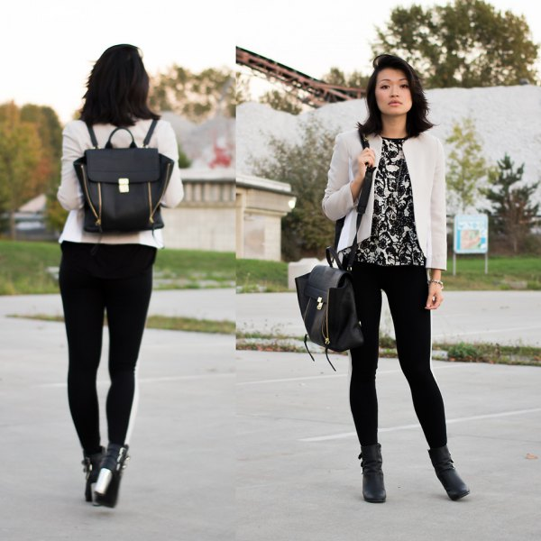 white blazer with black printed tee and leather purse