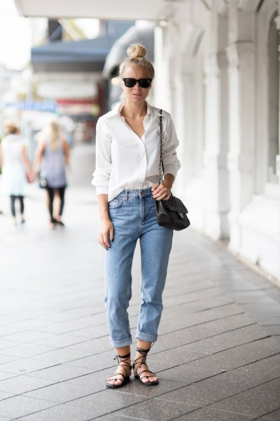 white button up shirt with light blue cuffed relaxed fit jeans