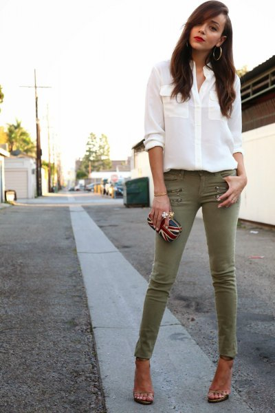 white chiffon button up blouse with olive green skinny pants