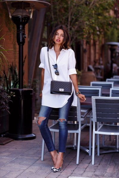 white cuffed tunic shirt with ripped skinny jeans
