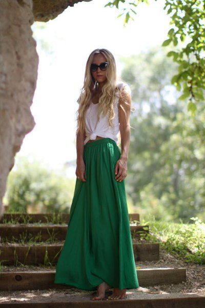 white knotted sleeveless t shirt with green flared maxi skirt