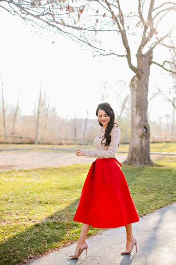 white lace blouse with red midi taffeta flared skirt