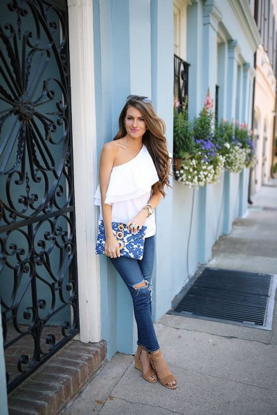 white one shoulder ruffle top with blue ripped jeans