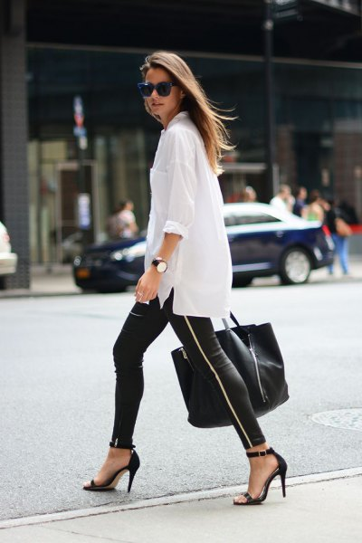 white oversized button up shirt with leather leggings and heels