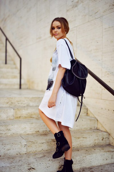 white printed t shirt dress with ankle boots with velvet backpack purse