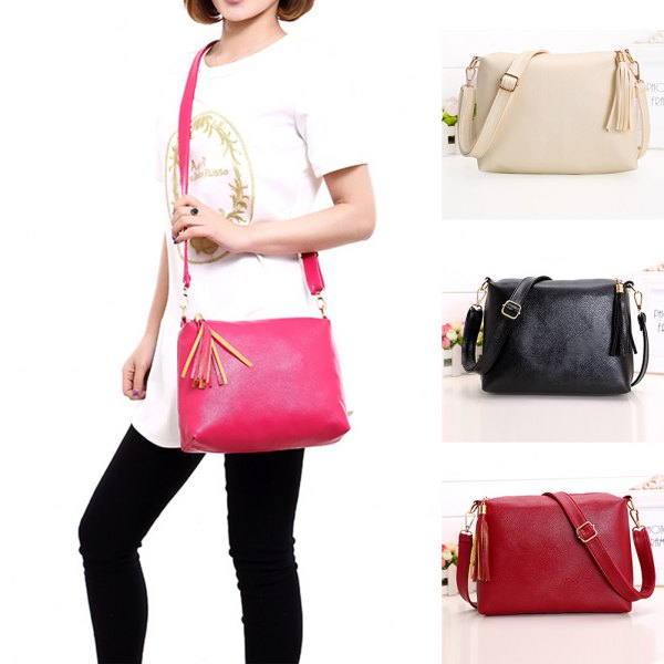 white printed tunic t shirt with black jeans and hot pink leather messenger bag