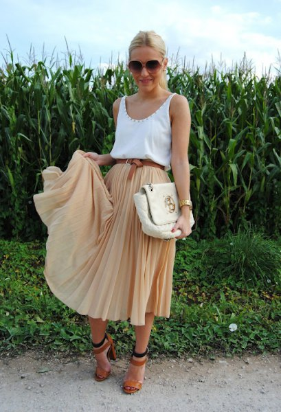 white scoop neck tank top with blush midi pleated skirt