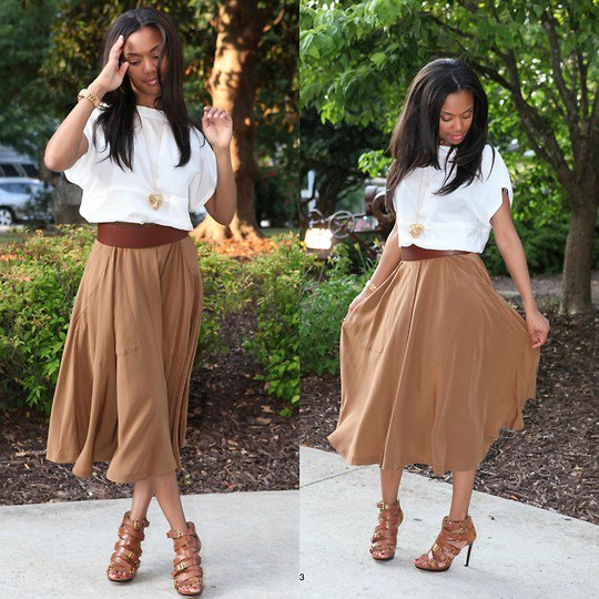 white short sleeve blouse with green flared midi skirt