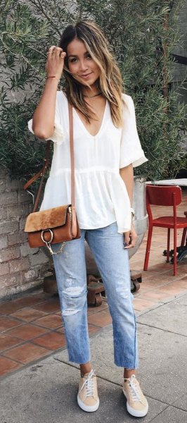 white short sleeve v neck peplum blouse with boyfriend jeans