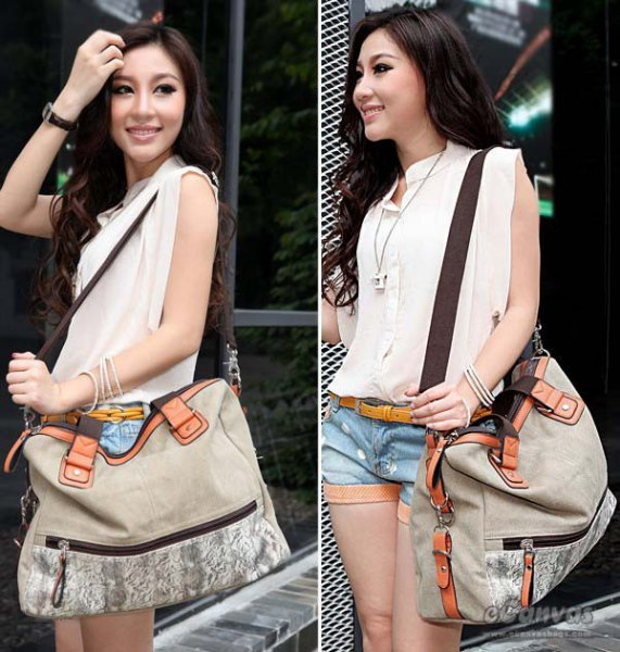 white sleeveless blouse with blue denim shorts and light grey messenger bag