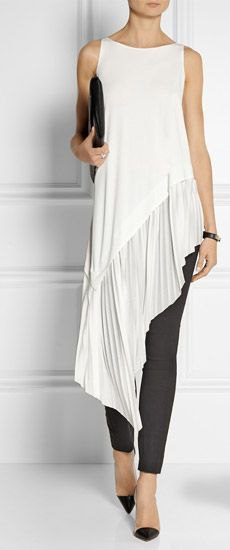 white sleeveless high low tunic blouse with black skinny jeans