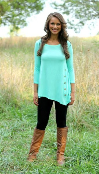 white three quarter sleeve tunic blouse with knee high leather boots