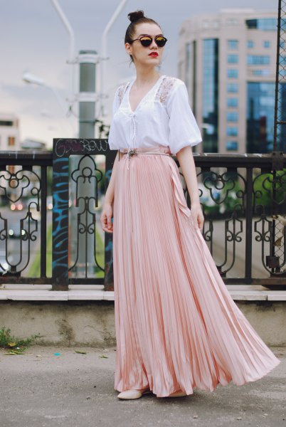 white v neck short sleeve blouse with pale pink flowy skirt