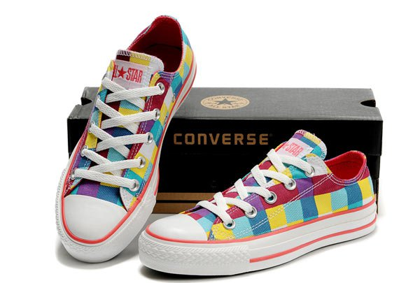 yellow blue red and white low top canvas sneakers