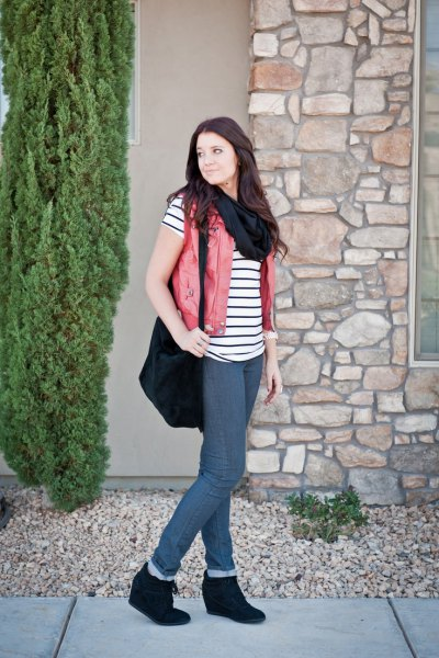 black and white striped short sleeve t shirt with beige vest and wedge boots