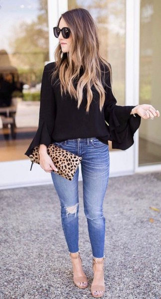 85f70d51b4ee1d Black Bell Sleeve Blouse with Skinny Blue Jeans & Leopard Print Clutch Bag