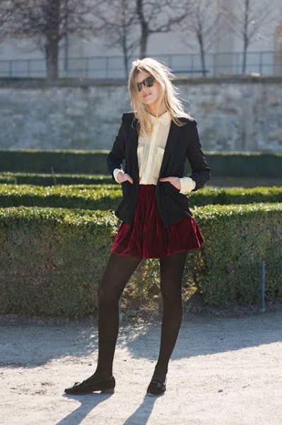 black blazer with burgundy mini skater skirt and velvet flats
