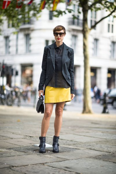 black blazer with yellow leather mini skirt and ankle moto boots