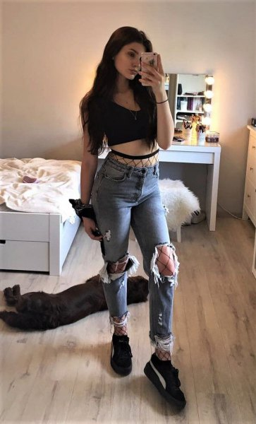 black cropped vest top with ripped boyfriend jeans and platform sneakers