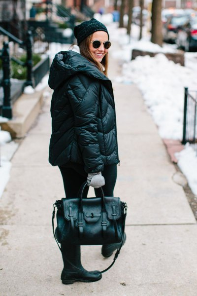 black down jacket with knit hat and mid calf boots