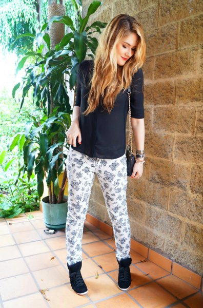 black half sleeve fitted sweater with white and pink printed relaxed fit pants