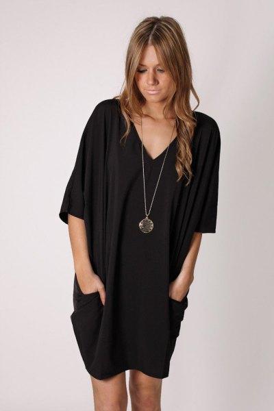black half sleeve side pocket v neck tunic dress