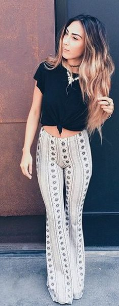 black knotted t shirt with white tribal printed bell bottom yoga pants