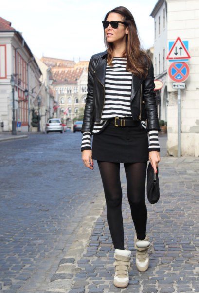 black leather jacket with striped tee and mini skirt
