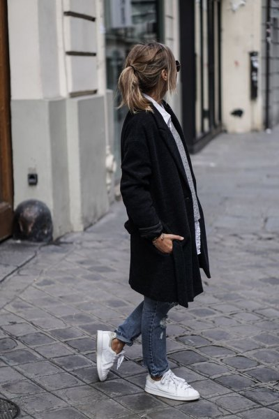 black long coat with grey sweater and white button up shirt