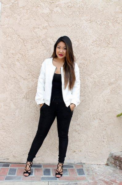 black scoop neck tank top and slim fit jeans