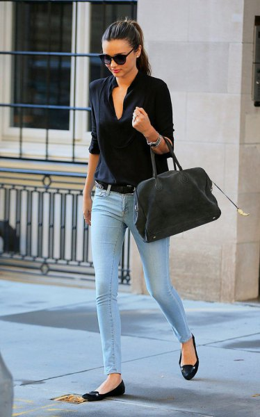 black shirt with light blue skinny jeans and ballet flats