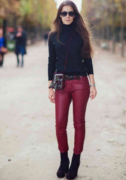 black turtleneck sweater with red skinny leather pants