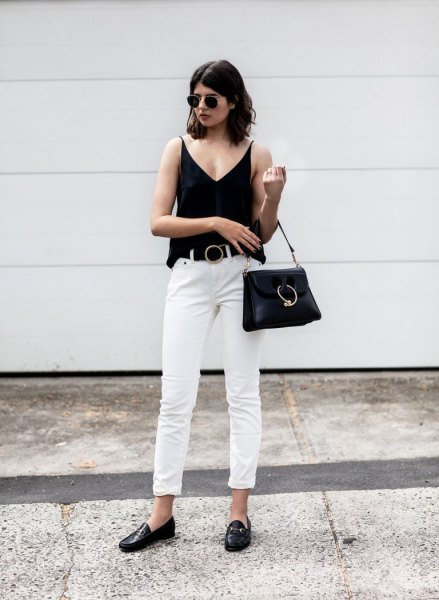 black v neck vest top with white cuffed straight leg jeans and loafers