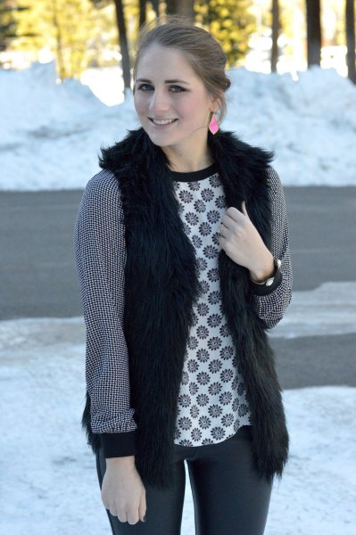 black vest with tribal printed long sleeve top and dark grey jeans
