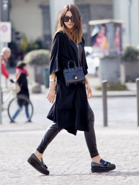 black wide half sleeve tunic dress with leather leggings and platform sneakers