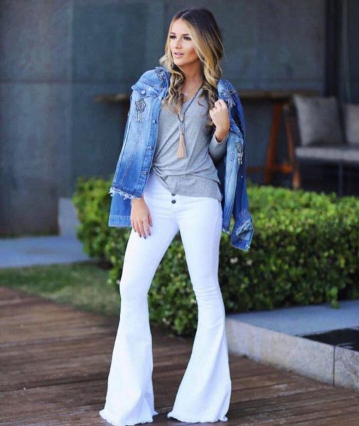 blue denim jacket with grey t shirt and white bell bottom jeans