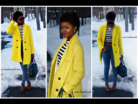 bright yellow double breasted coat with black and white striped tee