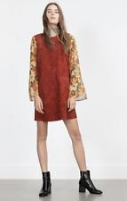 brown floral printed mini tunic dress with black heeled ankle boots