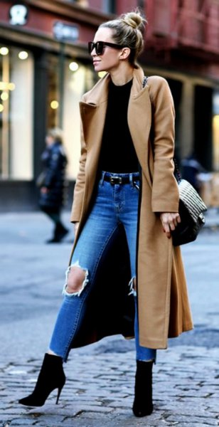 camel maxi length wool coat with black top and ripped blue jeans