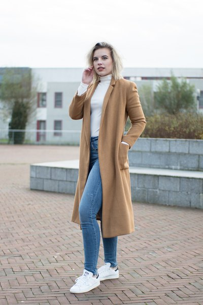 camel midi length wool coat with white mock neck form fitting sweater