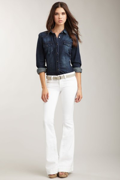 dark blue denim button up shirt with belted white jeans
