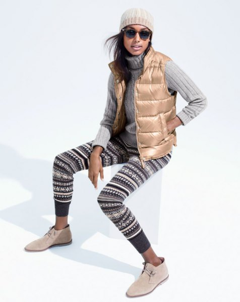 gold down vest with black and white tribal printed sweater leggings