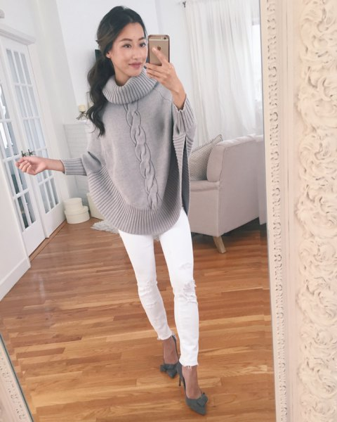 grey cable knit wide sleeve sweater with white slim fit jeans