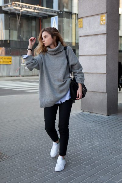 grey chunky sweater with light blue chambray shirt and white sneakers