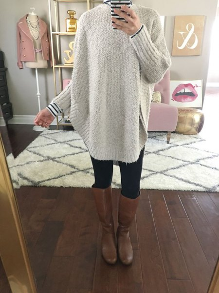 grey chunky sweater with striped tee and knee high leather boots